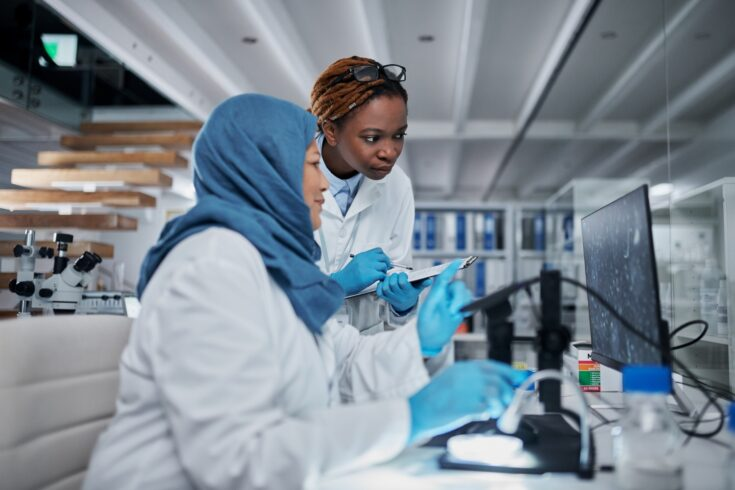 Black and Asian researchers in the lab