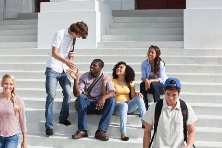 Students sat on steps of campus