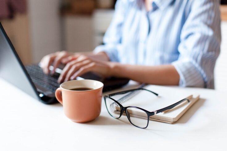 Woman working with laptop and coffee mug
