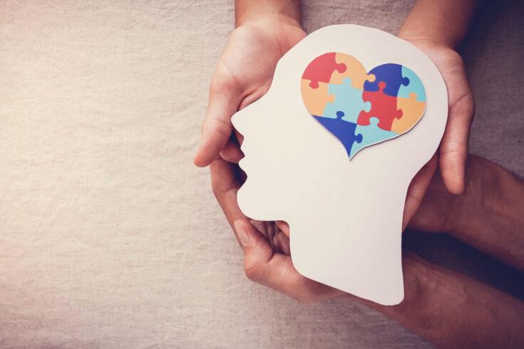 Puzzle jigsaw heart on brain, mental health concept.