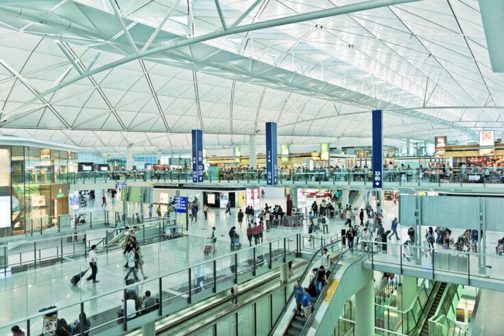 Travelers inside Hong Kong International airport, China, Asia.