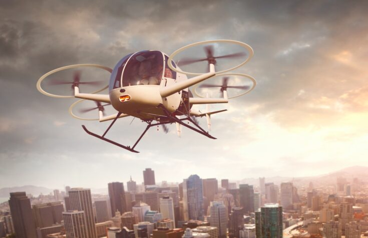 Futuristic drone flying over a city