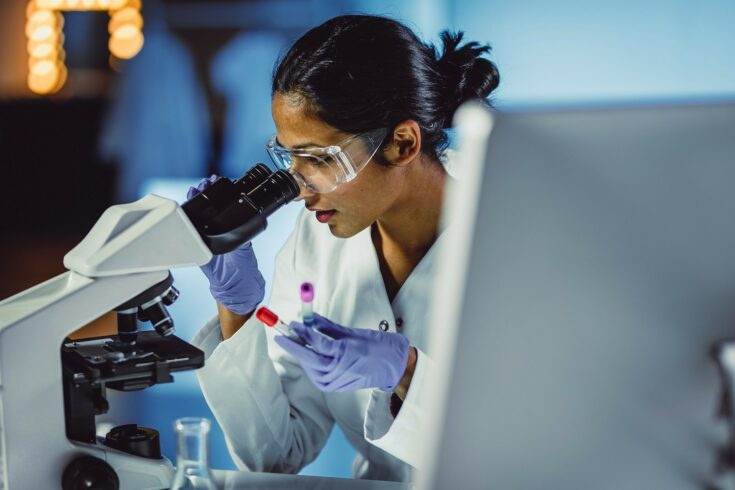 Scientist using a mircoscope