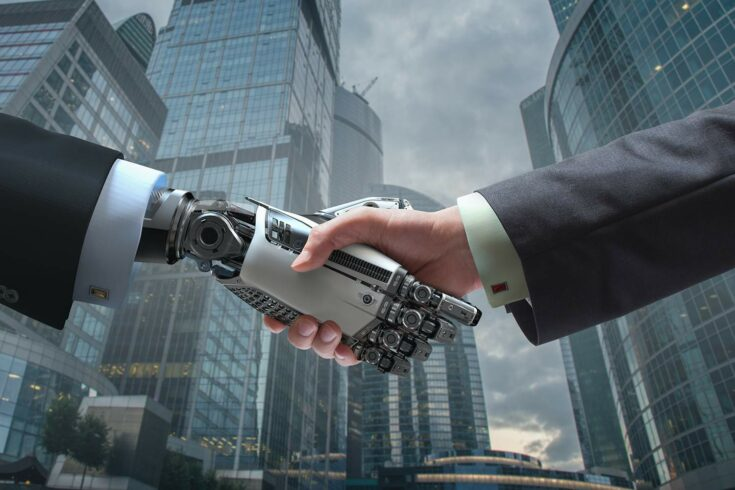 Robot and businessman shaking hands in cityscape