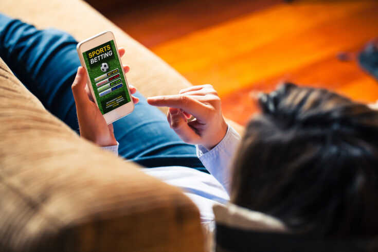 Mobile phone with sports betting website app in the screen