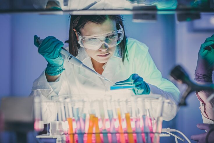 Scientist working at the laboratory using pipette