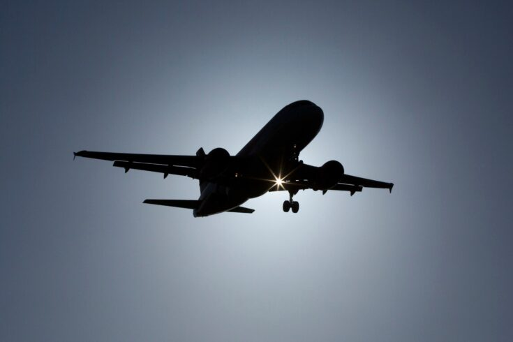 Silhouette of a plane coming into land