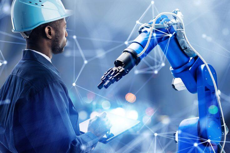 Supervisor checking manufacturing robot