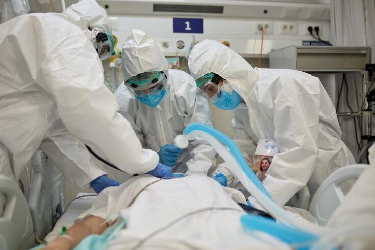 Emergency Team Using Ventilator to Aid Patient Breathing