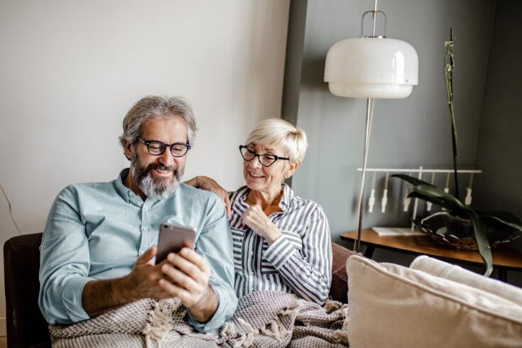 Seniors at home using smart phone