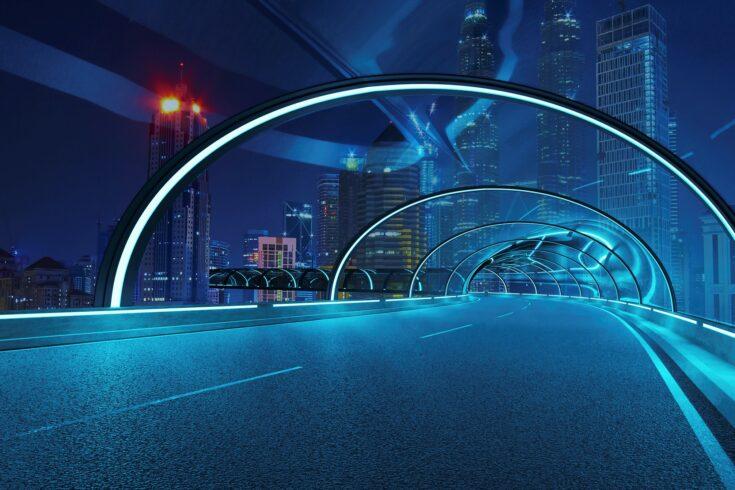 Futuristic neon light and glass facade design of tunnel flyover road