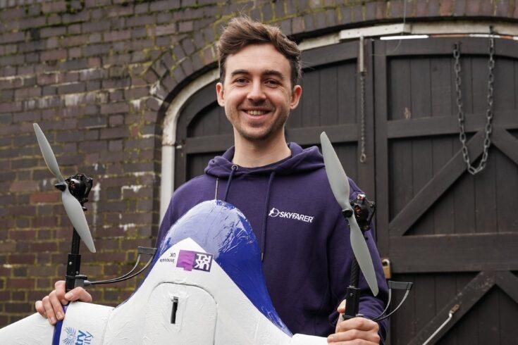 Man holding autonomous drone