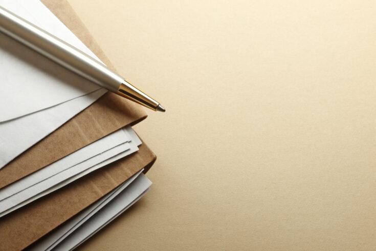 Ballpoint Pen On Stack Of File Folders