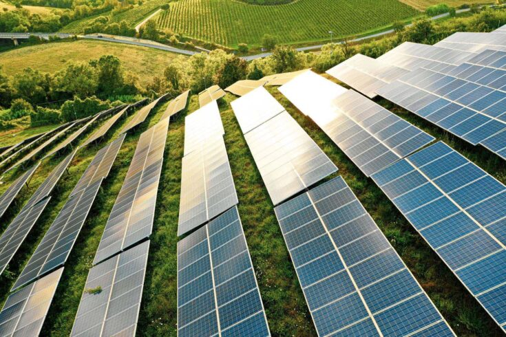 Solar panels fields on the green hills.